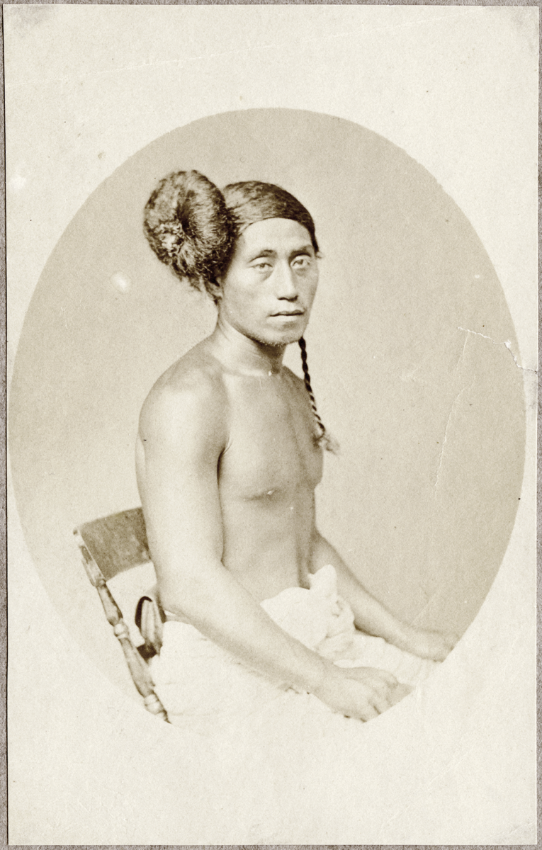 Black and white portrait photograph of a Samoan person with bound hair