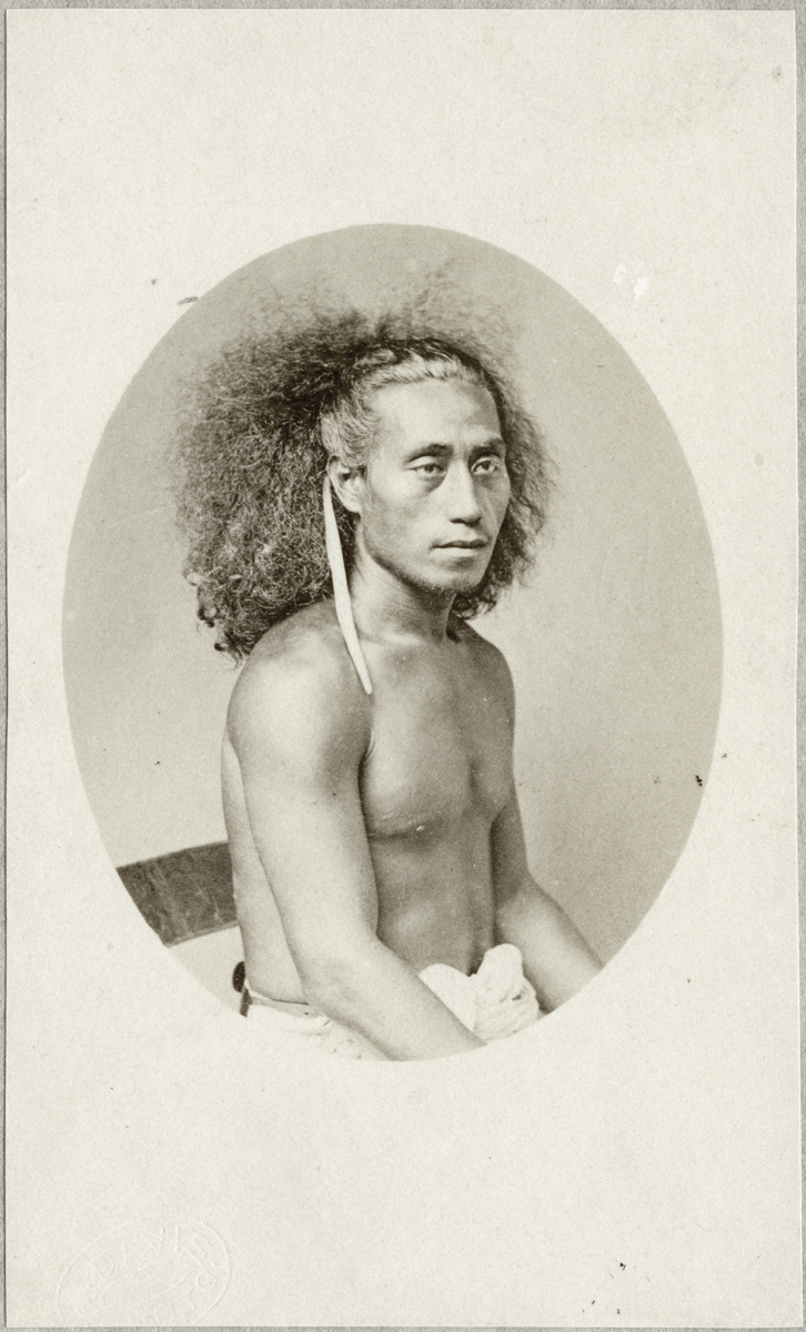 Black and white portrait photo of a Samoan person with untied hair