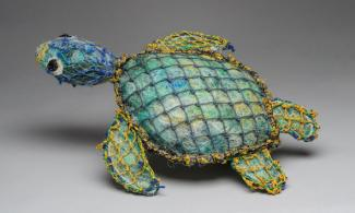 Turtle sculpture made from fishing nets