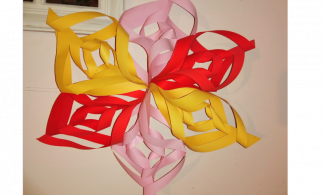 Yellow, pink and red decorative paper star