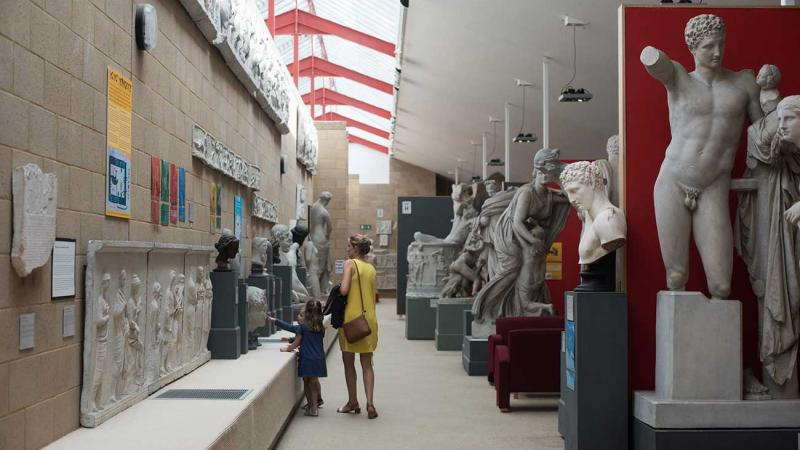 people exploring the casts inside the museum