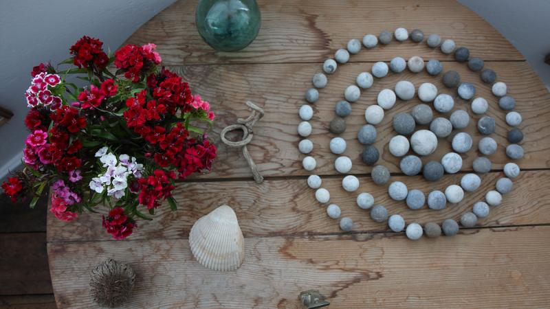 Spiral of Stones is an arrangement of 76 circular pebbles, carefully positioned by the creator of Kettle's Yard Jim Ede.