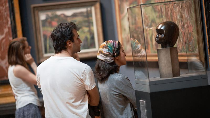 Visitors looking at art